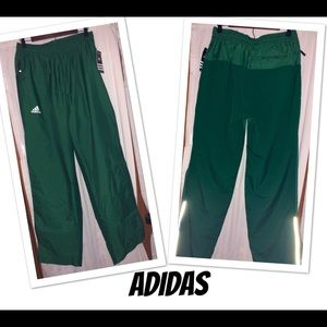NWT ADIDAS TRACK PANTS WITH ZIPPERED BOTTOMS!